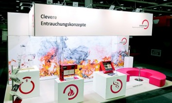 Simon RWA at Swissbau 2016: Set against brilliant white walls, stark images of blazing flames caught the visitors eye. (Photo: Syma)