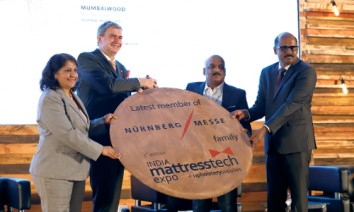 NürnbergMesse trio with the previous owner (from left): Sonia Prashar, Peter Ottmann, Unni Tharakan (seller of Mattresstech Expo) and Sivakumar Venugopal. (Photo: NürnbergMesse India)