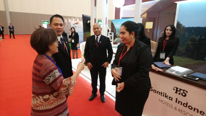 Organiser Indra Sukirno is vising the booth of Santika hotel chain.